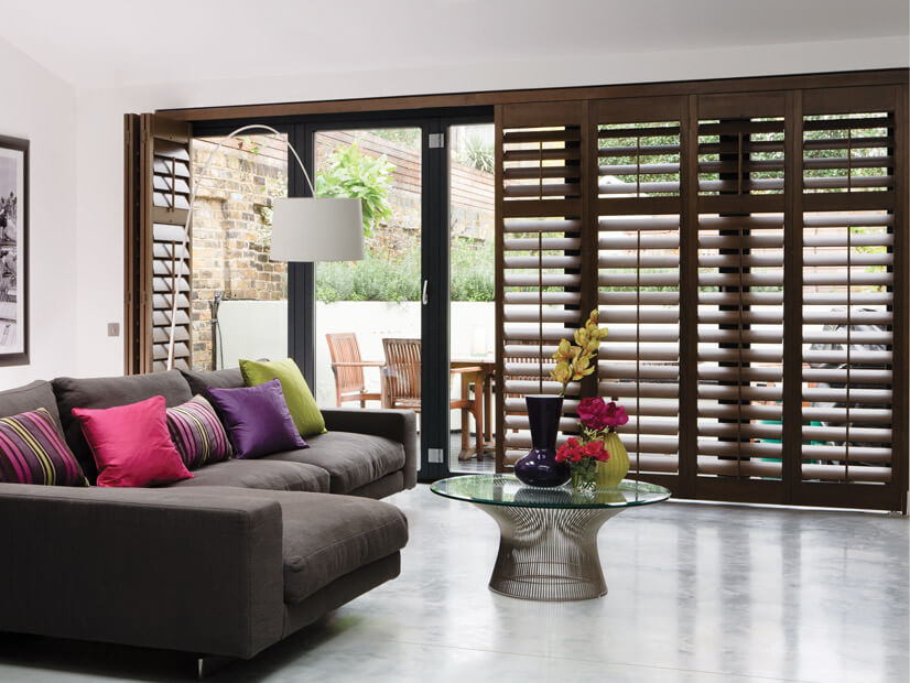 Brown plantation shutters in a living room
